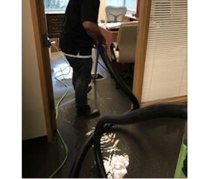 SERVPRO crew member extracting water.